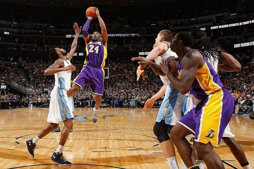 Kobe Bryant (second from left) taking a shot over Denver Nuggets' Will Barton. The LA Lakers star also did well in his defensive role, holding the hot-shooting Barton to two points in the second half.