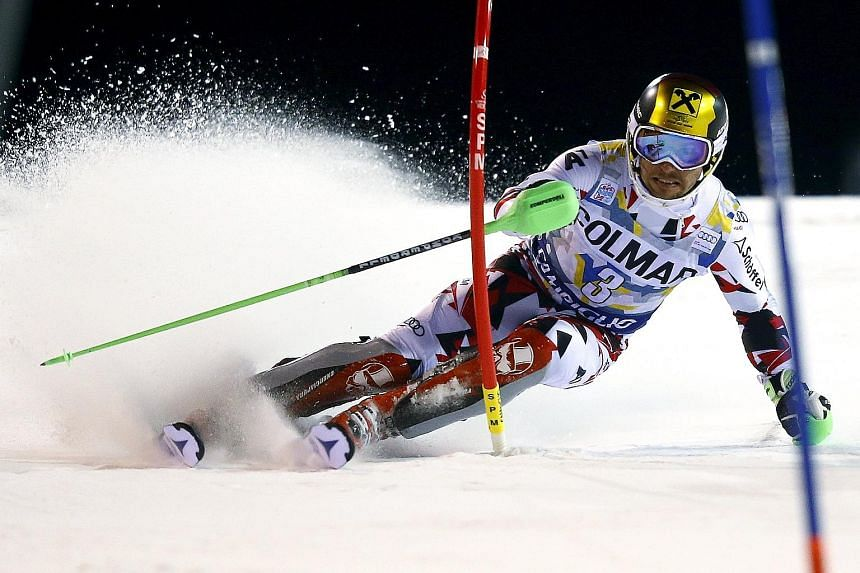 Marcel Hirscher of Austria clearing a gate during the first run in the men's slalom at the Alpine Skiing World Cup.