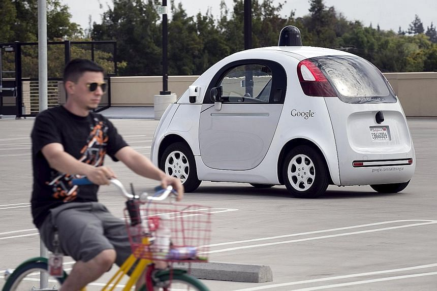 A Google employee on a bicycle acting as a real-life obstacle for a Google self-driving car to react to, during a media preview of the Internet giant's prototype autonomous vehicles in Mountain View, California, in September. Google has logged more t