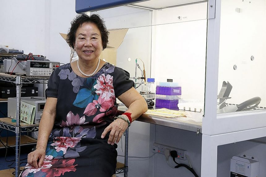 Madam Long (above) has a firm - Singapore Biomicro - which is developing a wireless, implantable blood glucose monitoring device (left) to eliminate daily finger-prick blood tests for diabetics.