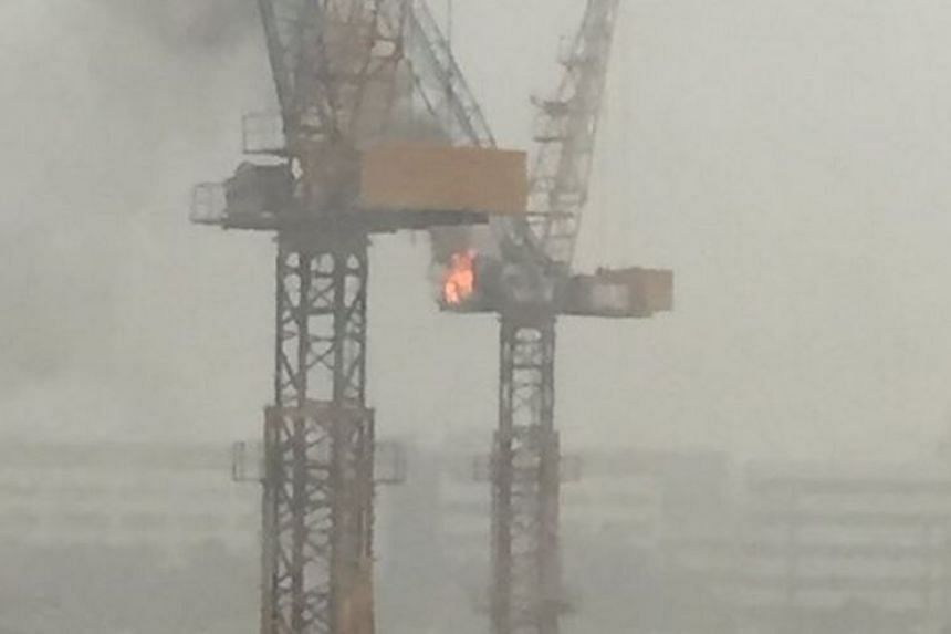 The construction crane's operator cabin on fire.