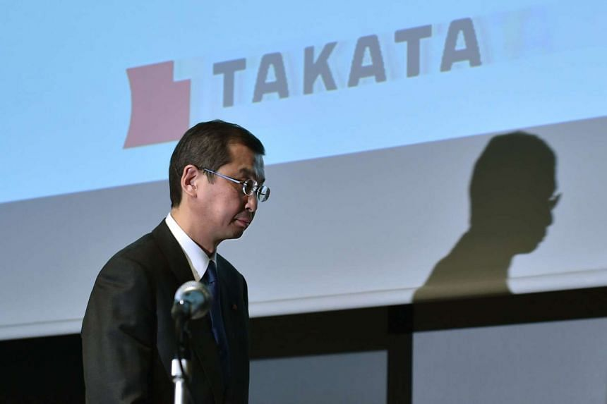 Japanese parts supplier Takata Corp Chairman and President Shigehisa Takada leaves after a press conference in Tokyo on Nov 4.