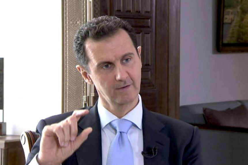 Syrian President Bashar al-Assad speaks during a TV interview in Damascus in this still image taken from a video on Nov29.