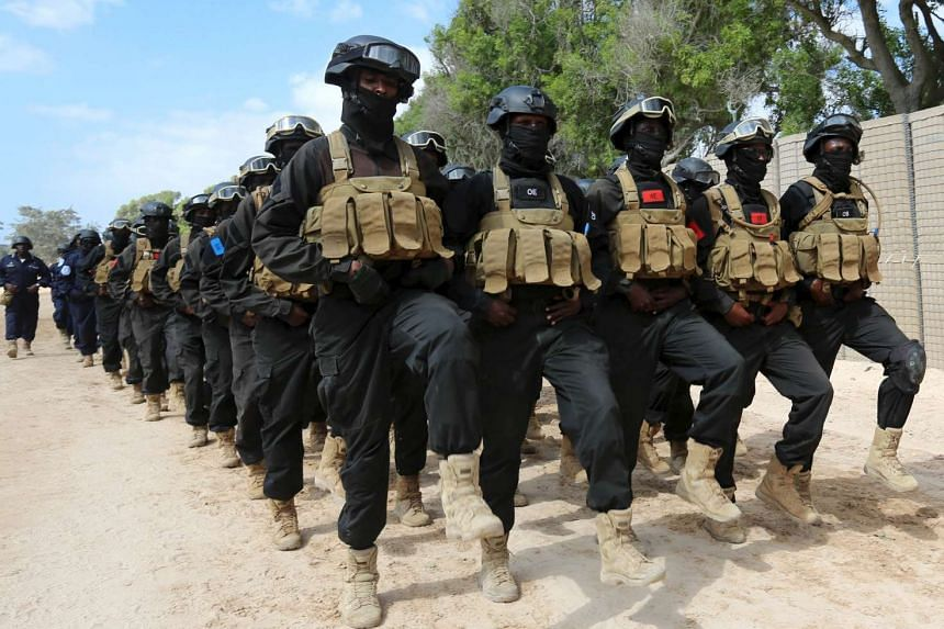 Somali police march during a passing out parade to mark the force's 72nd anniversary in the capital Mogadishu on Sunday.