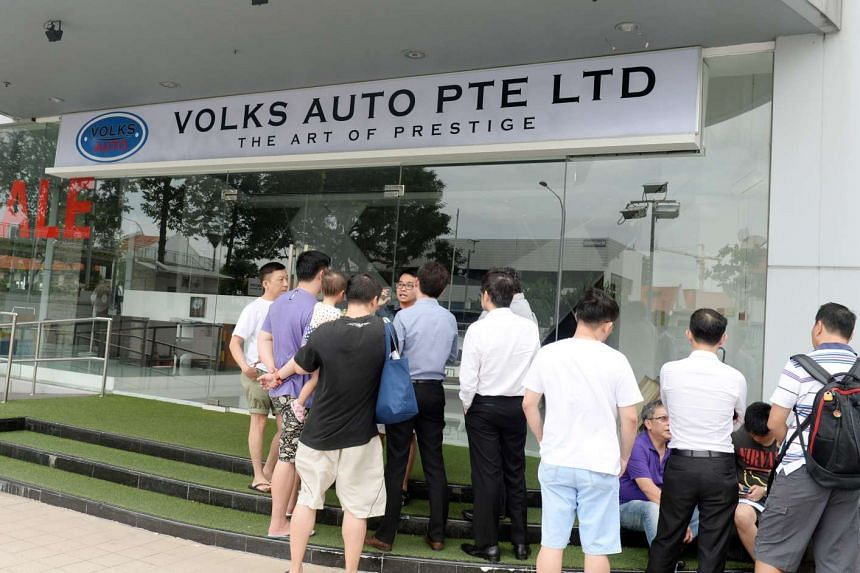 Last December, customers gathered outside Volks Auto in MacPherson Road, looking for the owner. The firm had collected over $3.6 million from more than 100 buyers without delivering the cars. Police later confirmed that the owner had left Singapore i