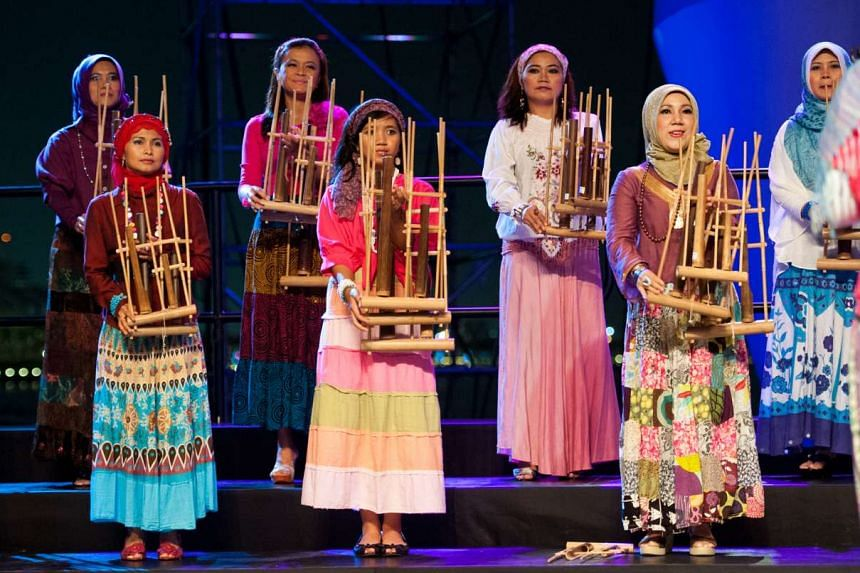 Indonesian angklung troupe Sahabat Angklung performs at the Esplanade's Outdoor Theatre on Sunday.