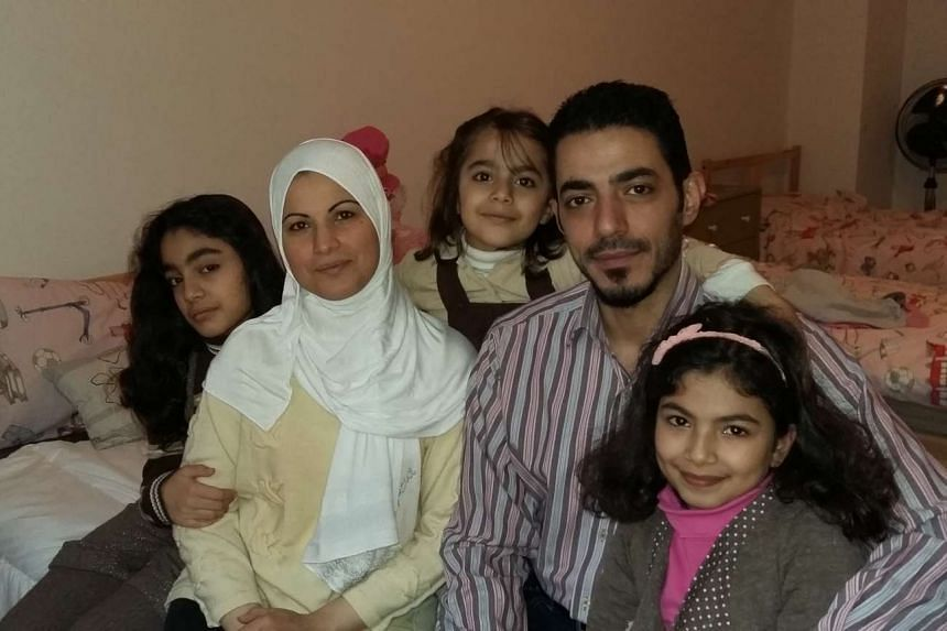 Syrian migrant Fadi Haddad with his wife Ranya and three daughters in their Frankfurt flat. His family joined him from Istanbul, after he arrived in Germany where he gained refugee status.