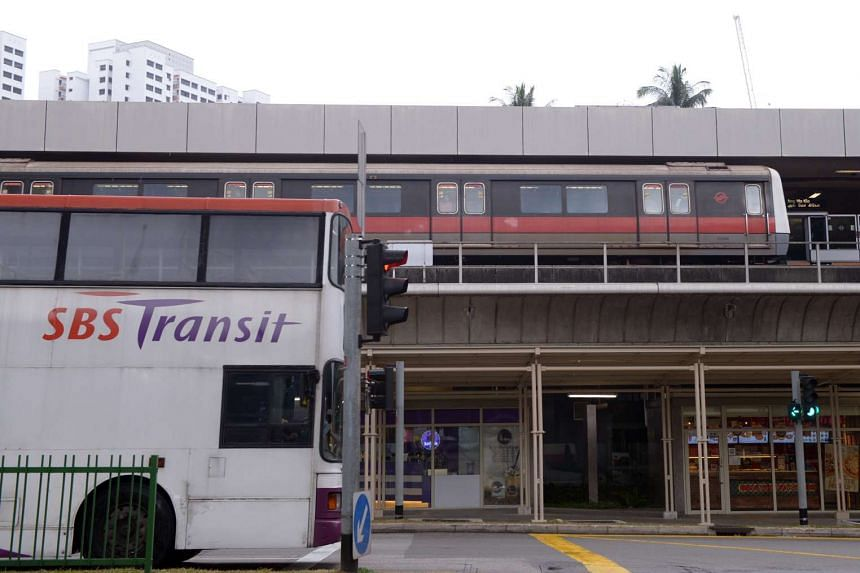 Train at the MRT station and SBS bus at a traffic junction in Ang Mo Kio on Jan 21, 2015.