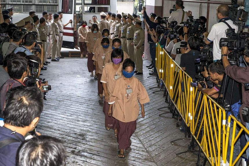 Human trafficking suspects arrive at the criminal court in Bangkok, Thailand, on Nov 10, 2015.