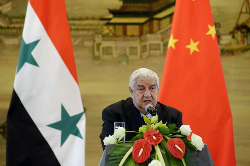 Syria's Foreign Minister Walid al-Moualem speaking in Beijing, China, on Dec 24, 2015.