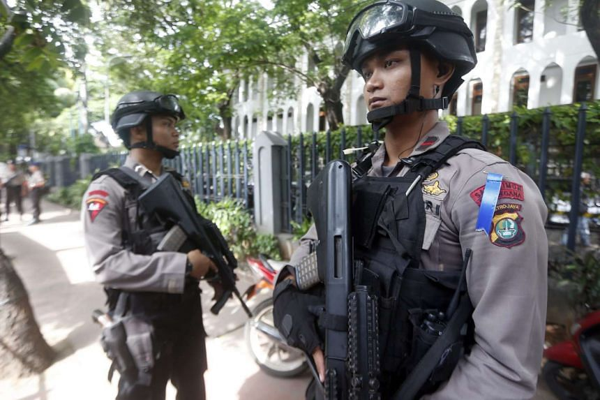 Indonesian police bomb squad members standing guard in front of a church in Jakarta on Dec 24, 2015.