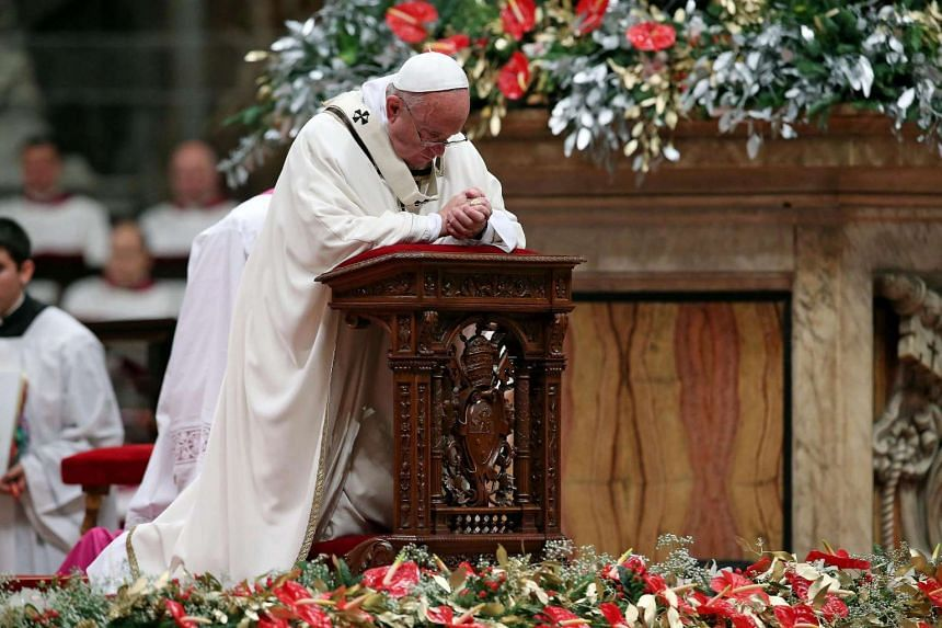 Pope Francis leads the midnight Christmas Mass in Saint Peters Basilica at the Vatican City, Dec 24, 2015.