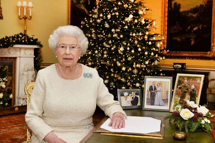Britain's Queen Elizabeth II sitting at a desk in the 18th Century Room at Buckingham Palace in London, Britain, after recording her Christmas Day broadcast to the Commonwealth.
