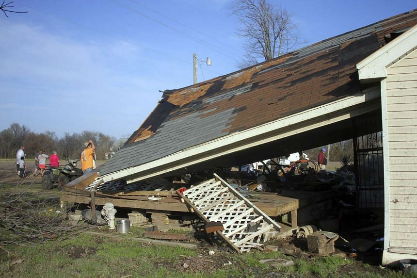 A damaged house is seen after being struck by a powerful tornado in Clarksdale, Mississippi on Dec 24, 2015.