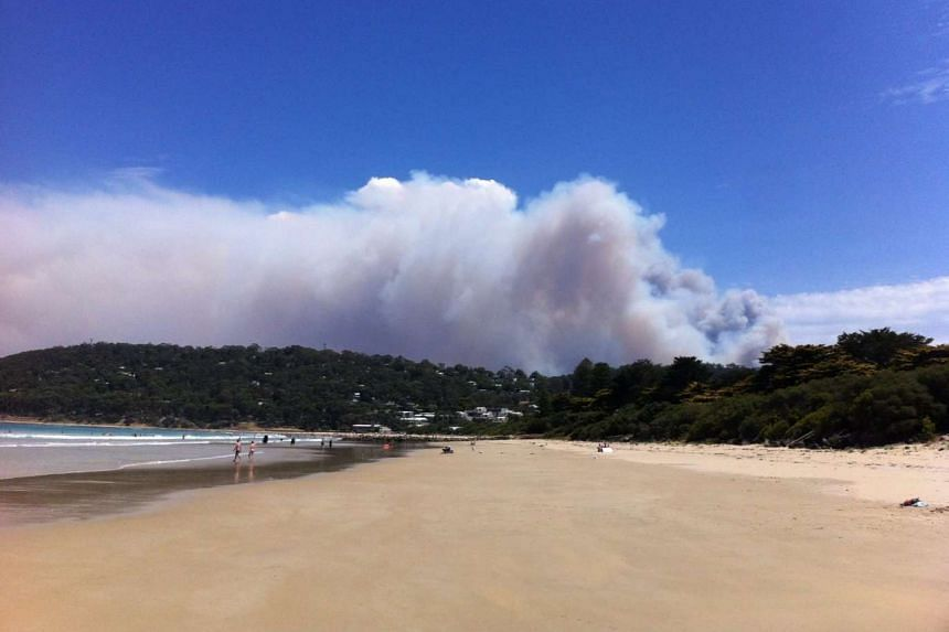 Smoke rising from a fast-moving bushfire near the Great Ocean Road in Victoria, Australia, on Dec 25, 2015.