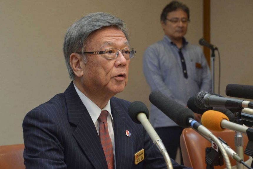 Okinawa Governor Takeshi Onaga announcing the decision to countersue at his office in Naha on Dec 25, 2015.