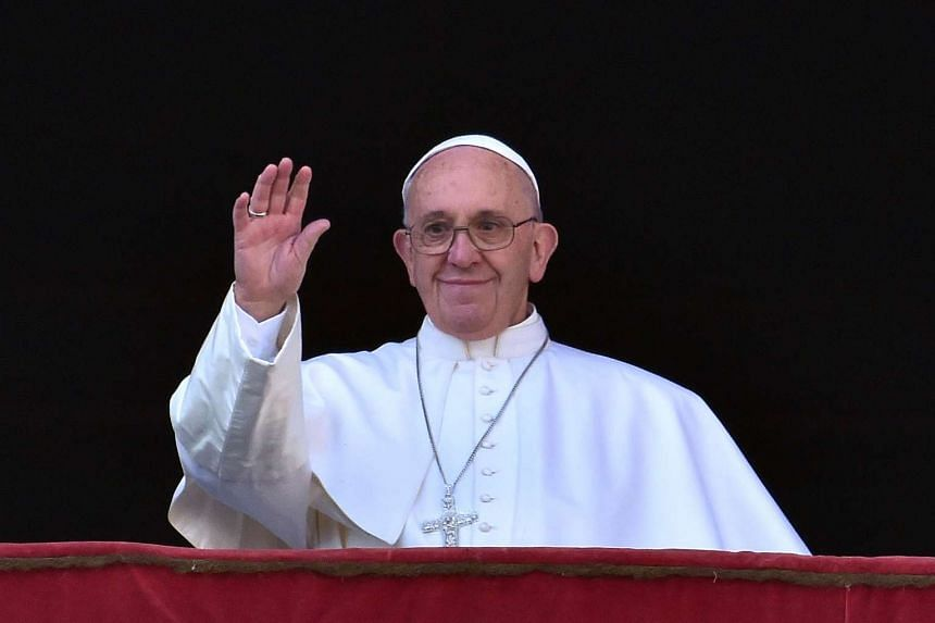 Pope Francis waving from the balcony of St Peter's Basilica on Dec 25, 2015.