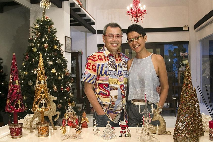 Mr Philip Seah and his wife Christine Chan in the living room of their two-storey, semi-detached house in Telok Kurau.