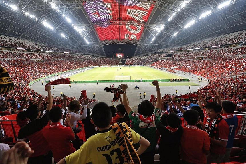 Fans celebrate as Singapore score the equaliser against Thailand in the AFF Suzuki Cup in November 2014. The now-rescheduled Merlion Cup was originally slated to be played at the National Stadium as well, in hopes of rallying the football community t