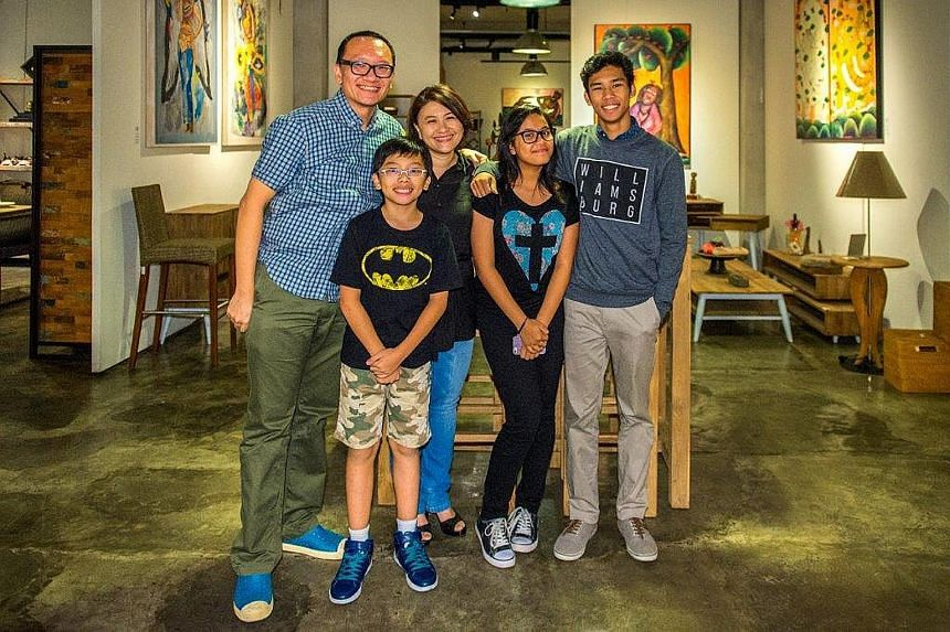"""Mr Goh Soo Sing and his wife Sha-Rin Low with their three children Chang Jernn, 12; Di Yann, 14; and Chang Hann, 17. Both Di Yann and Chang Hann were adopted from Indonesia. Says Chang Hann: """"My parents have been very honest with me, so I never had a"""