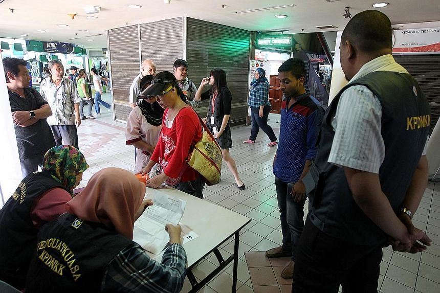 Domestic Trade Ministry officials taking down complaints from customers who were allegedly cheated at Kota Raya mall.