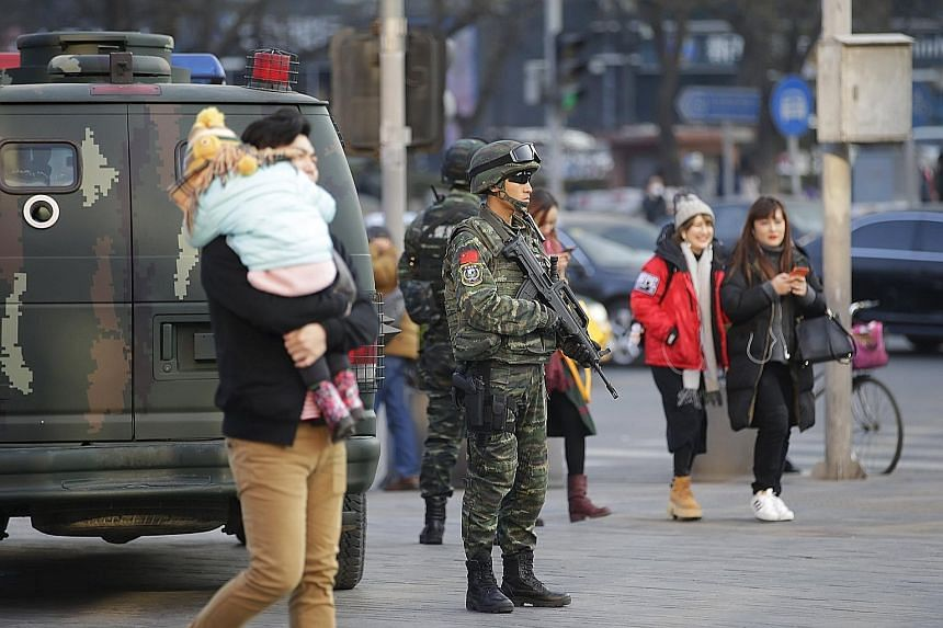 Members of a commando unit standing guard yesterday in Sanlitun, a shopping and dining area in Beijing. The US embassy in the Chinese capital says it has received information of possible threats against Westerners on or around Christmas Day in Sanlit
