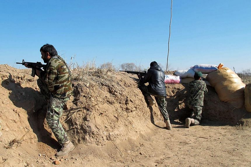 Afghan forces in an operation against Taleban fighters in Helmand on Tuesday. Kabul has rushed reinforcements to the province after the Taleban captured large swathes of a strategic district.