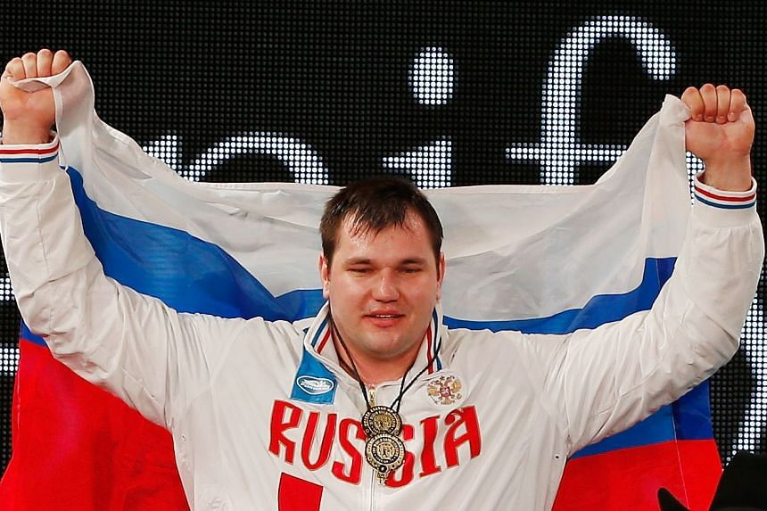 Lovchev on the podium at the 2015 International Weightlifting Federation World Championships.