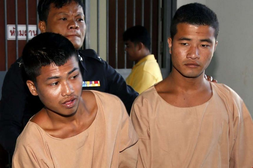 Zaw Lin (right) and Wai Phyo (left) escorted by a Thai police officer after they were sentenced to death at the Samui Provincial Court, on Koh Samui Island, southern Thailand, Dec 24, 2015.