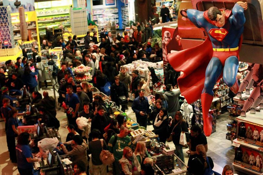 Customers shop in Toys'R'Us in Times Square on Nov 26, 2015.