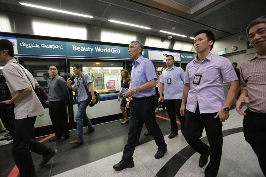 PM Lee Hsien Loong arriving at Beauty World station from Botanic Gardens station during a tour of Downtown Line 2 on Dec 26, 2015.