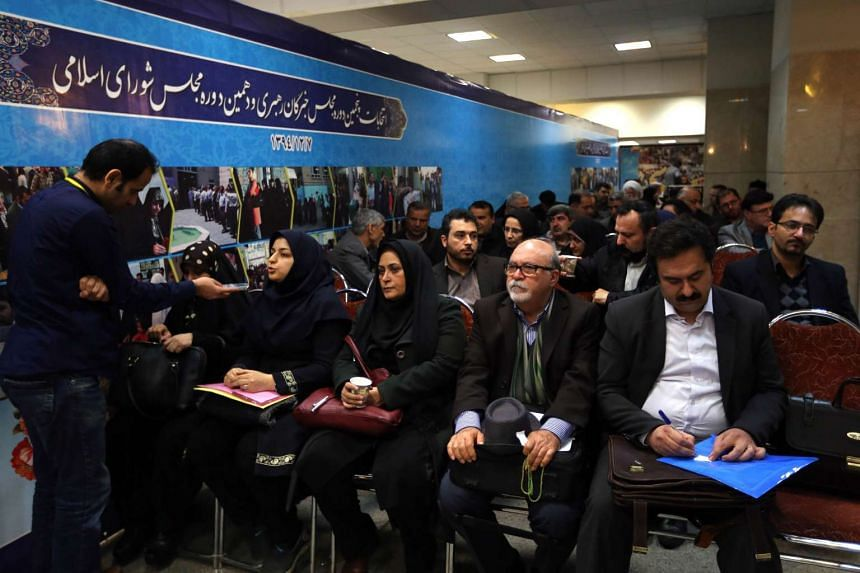 Iranian hopefuls wait to register their candidacy at the interior ministry in Teheran on Dec 21, 2015.