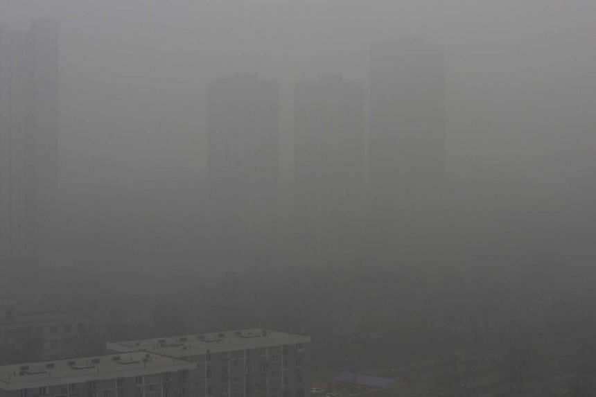Residential buildings are pictured amid heavy smog in Beijing, Chinaon Dec 25, 2015.