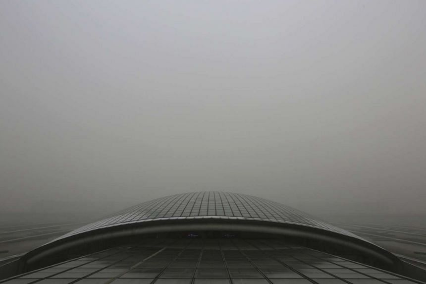The roof of Beijing Capital Airport T3 Terminal Building is pictured amid heavy smog in Beijing, Chinaon Dec 25, 2015.