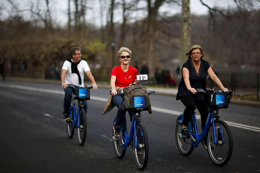 Women enjoying a warm day on their bikes in Central Park, New York on Dec 25, 2015.