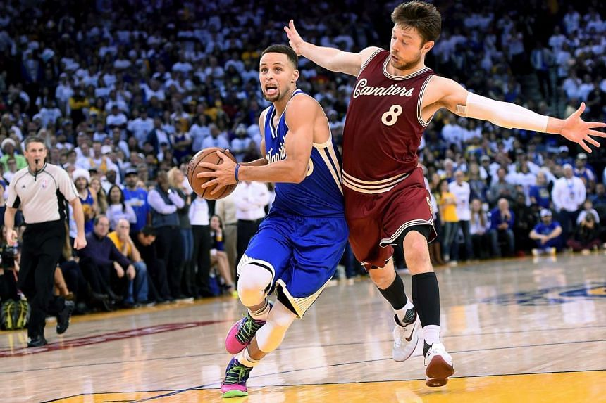 Stephen Curry of the Golden State Warriors drives to the basket against Matthew Dellavedova of the Cleveland Cavaliers.