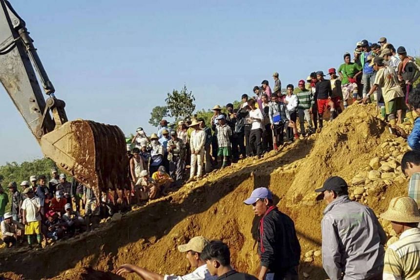 People searching for miners killed by a landslide at Hpa Kant jade mining area, Kachin State, northern Myanmar on Nov 22, 2015.