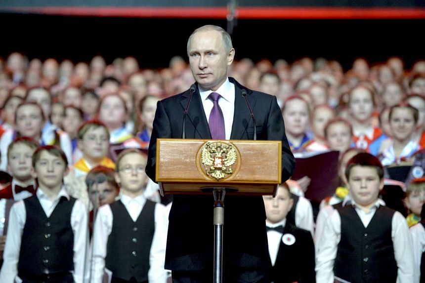 President Vladimir Putin delivers a speech during a concert of the Children's Choir of Russia on Dec 25, 2015.