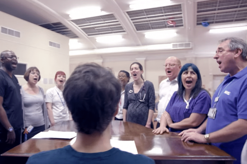 A screenshot from the NHS Choir's video for A Bridge Over You.