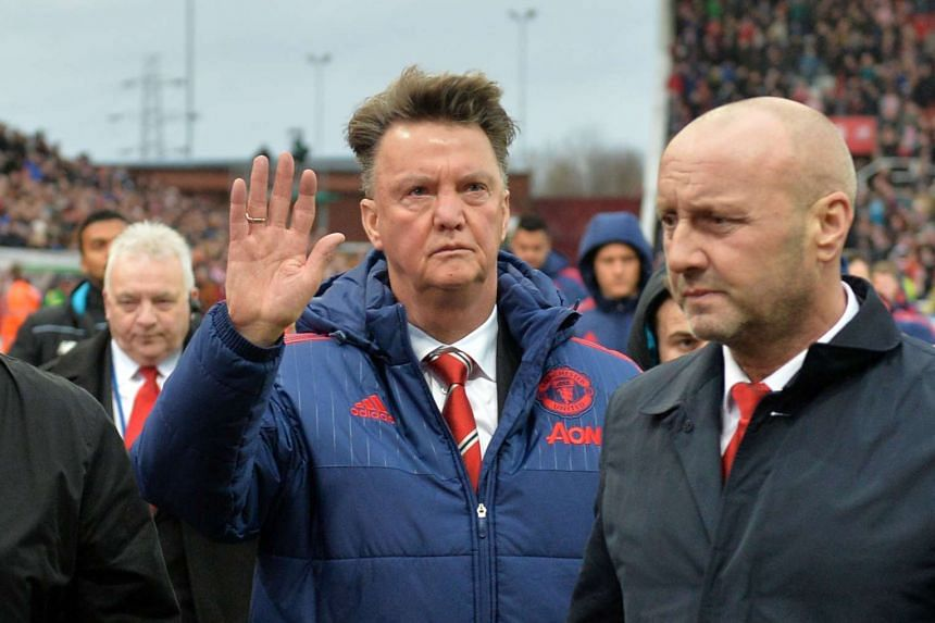 Van Gaal (centre) waves as he leaves after the match.