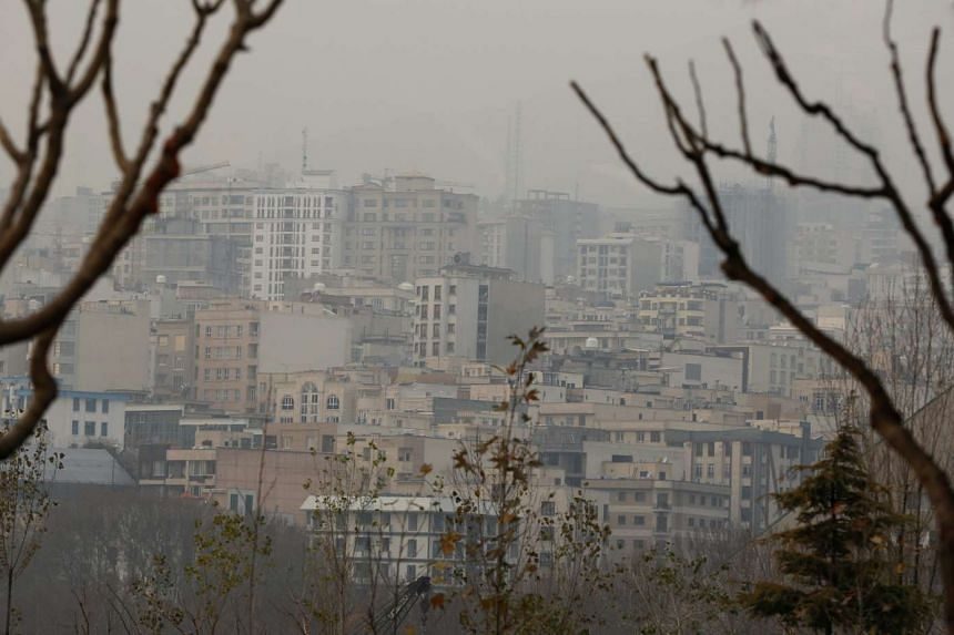 Smog covers the skyline of Teheran as air pollution levels rose, on Dec 19, 2015.