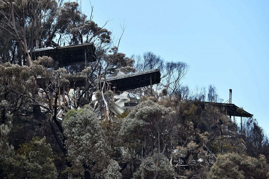 Fire-damaged buildings are seen at Wye River in the Otway Ranges, south of Melbourne, on Dec 27, 2015.