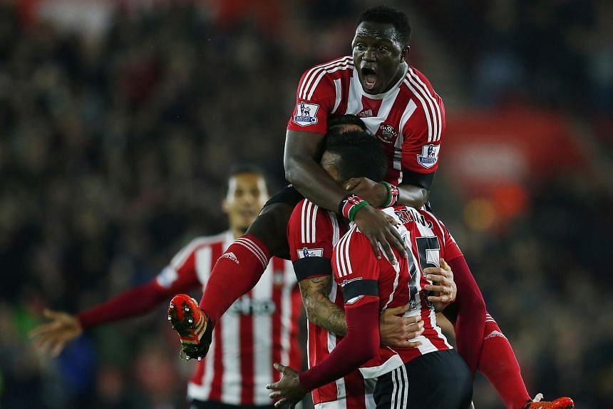 Cuco Martina celebrates with Victor Wanyama after scoring the first goal for Southampton.
