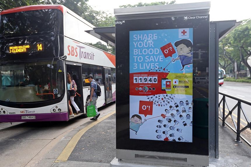 A blood donation advertisement at bus stop along Penang Road.
