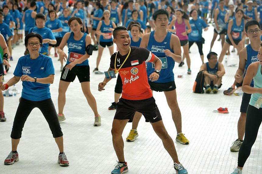 LionsXII captain Isa Halim taking part in a mass Zumba workout at the Sports Hub on Sept 28, 2014.