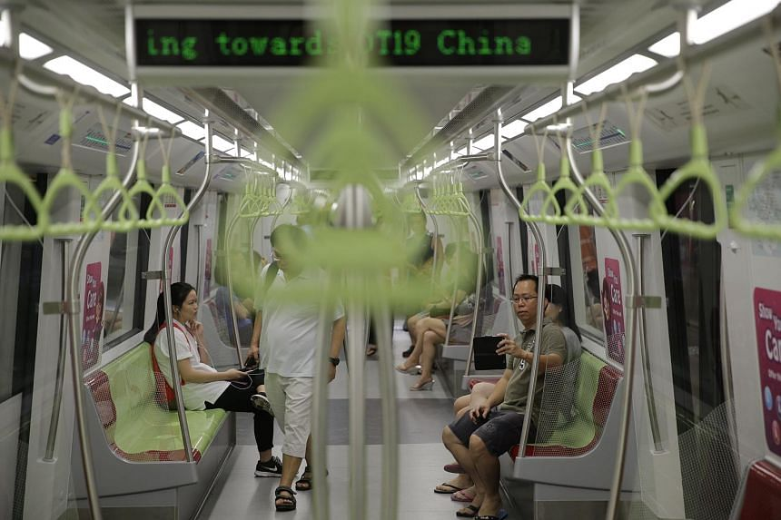 Commuters aboard the train at Bukit Panjang station of Downtown Line 2 on Dec 27, 2015.