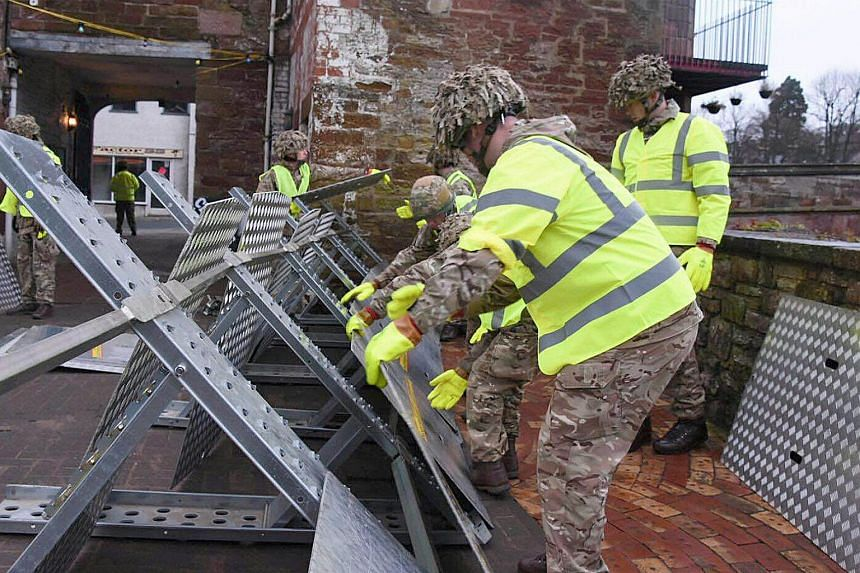 Soldiers helping set up flood defences in Appleby, United Kingdom on Dec 25, 2015.