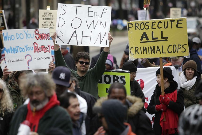 Demonstrators protesting against the fatal police shooting of Laquan McDonald along Michigan Avenue in Chicago, Illinois on Dec 24, 2015.