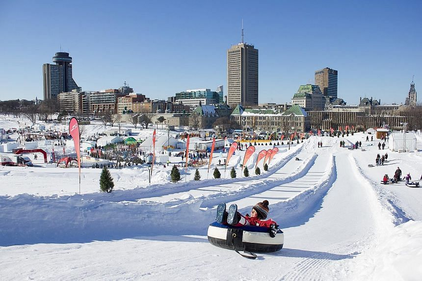 Snow tubing at the Carnaval de Quebec, a winter festival which has been held in the Canadian city since 1894.