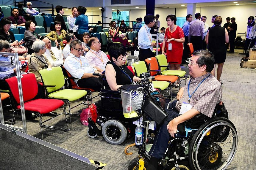 The special auditorium at the Enabling Village in Lengkok Bahru, made possible with a donation from UOB, is equipped with technology to help those with hearing aids, and has portable ramps, spaces reserved for wheelchairs and steps fitted with LED li